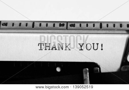 Typewriting on an old typewriter. Typing text: thank you !
