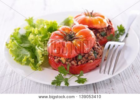stuffed tomato with beef and salad