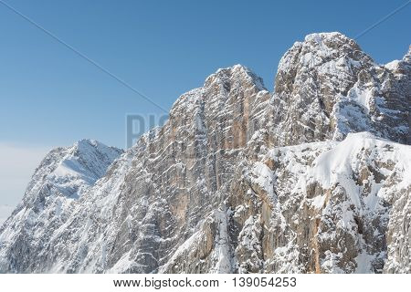 covered mountains of the Dachstein Massif glowing in sunlight