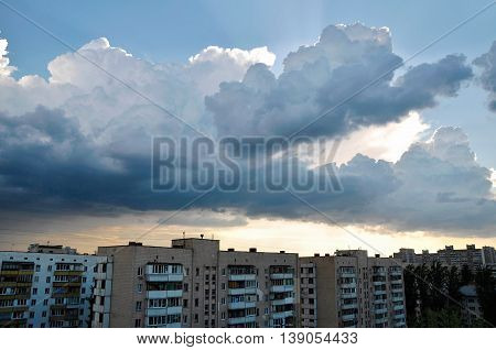 Cumulonimbus clouds over the buildings Kharkivskyi neighborhood of Kyiv