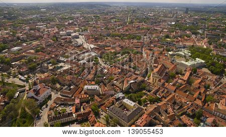 Sunny day aerial panorama shot of old town in capital of Lithuania Vilnius