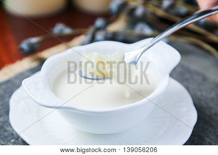 Sweet soup of salanganes or bird's nest in a white cup in asia