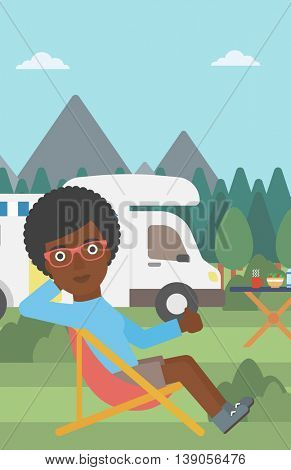 An african-american woman sitting in folding chair and giving thumb up on the background of camper van. Woman enjoying vacation in camper van. Vector flat design illustration. Vertical layout.