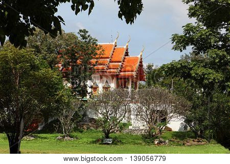 beautiful Buddhist temple gable, in forest of Thailand