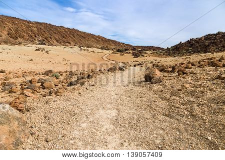 Footpath leading through volcanic landscape of Tenerife island Spain