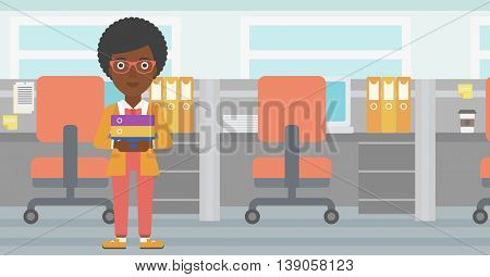 An african-american business woman standing with pile of folders in the office. Business woman carrying stack of folders. Vector flat design illustration. Horizontal layout.