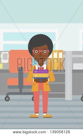 An african-american business woman standing with pile of folders in the office. Business woman carrying stack of folders. Vector flat design illustration. Vertical layout.
