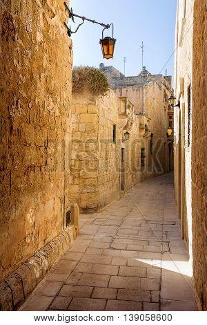 Ancient narrow street in fMdina old capital of Malta.