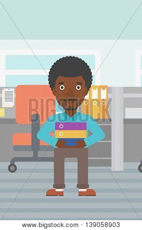 An african-american businessman standing with pile of folders in the office. Young businessman carrying a stack of folders. Vector flat design illustration. Vertical layout.