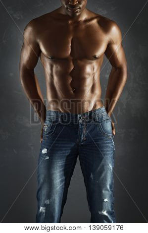 Sexy African male model wearing jeans and topless.