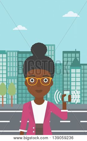 An african-american woman holding ringing mobile phone on a city background. Woman answering a phone call. Woman with ringing phone in hand. Vector flat design illustration. Vertical layout.