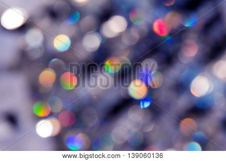 Blurred reflections of the light. Unfocused image of multi-colored light