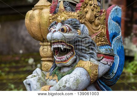 Close up of traditional Balinese God statue in Central Bali temple. Indonesia