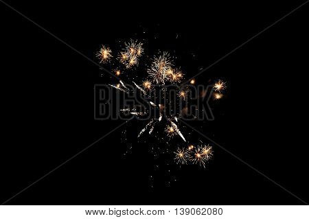 Celebration fireworks isolated on black background. Glowing texture.