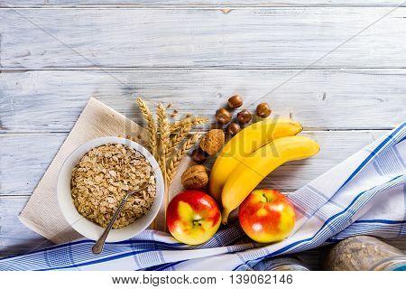 Oatmeal with apple banana grape chocolate. Bowl of fresh fruit.