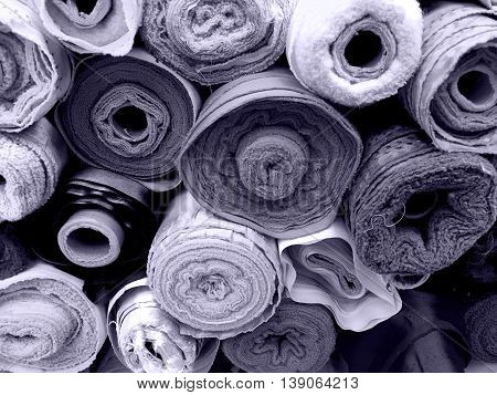 A lot of fabric rolls in blue tone background