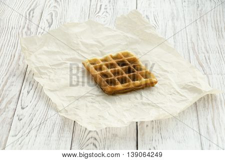 Homemade baking. Viennese waffle on wrapping paper. Copy space composition