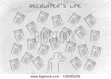 Stressed Recruiter Surrounded By Lots Of Resumes