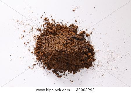 Grounded coffee on the white background