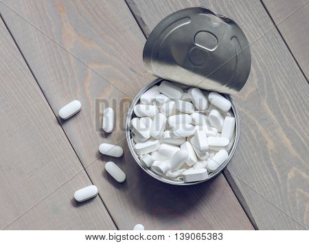 Pills in a tin can
