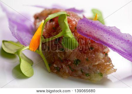 Close-up of a plate of pork steak tartar.