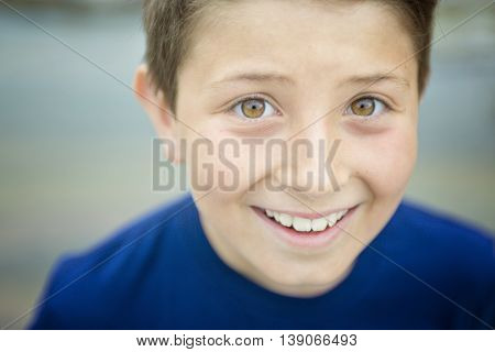A close up of a cute 8 year old boy