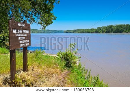 Bank of Missouri River with a wooden Notice Board