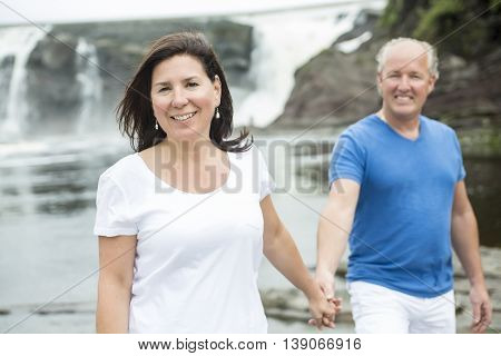 A Portrait of loving mature couple relaxing outside
