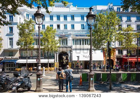 PARIS, FRANCE - July 17 : Tourists on foot Graben Street view around Paris city. Paris is the capital and most populous city of France.July 17, 2016, Paris, France.