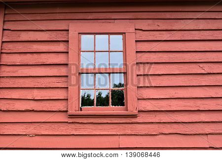 Old wooden wall with window painted red background