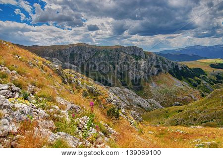 Montenegro national park Durmitor mountains and clouds panorama. Sunlight lanscape. Nature travel background.