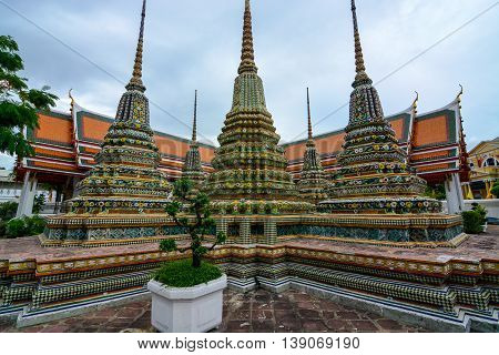 Bangkok, Thailand - June 30, 2016: Cluster of five chedis containing relics of Buddha at Wat Pho
