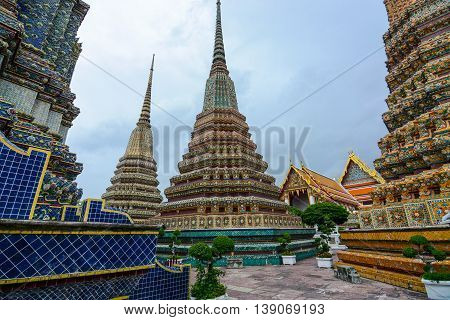 Bangkok, Thailand - June 30, 2016: View between two of the giant chedis built for Thai kings at Wat Pho