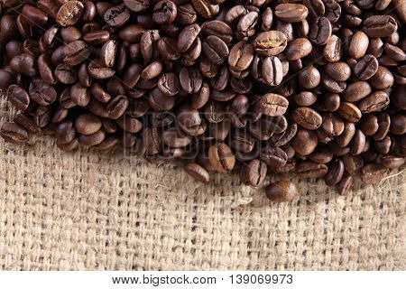 top view of roasted coffee bean on sack cloth