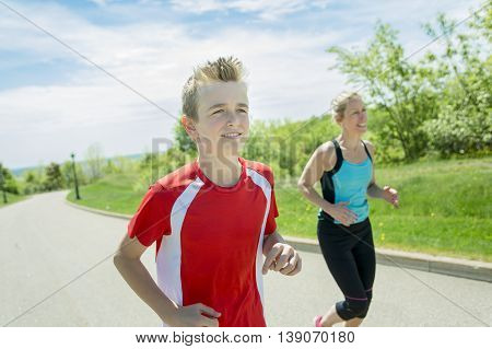 A Family, mother and son are running or jogging for sport outdoors