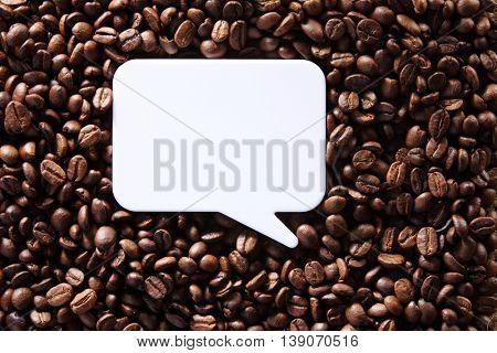 roasted coffee bean with blank speech bubble for copy