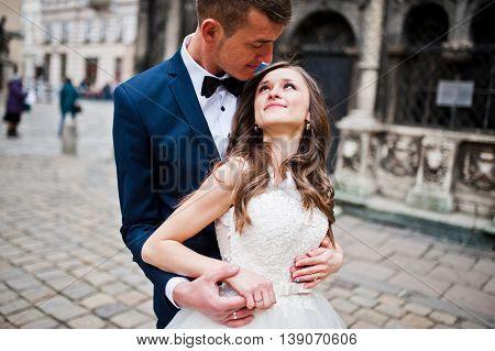 Wedding Couple Near Old Architecture