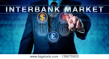 Investor is pressing INTERBANK MARKET on an interactive touch screen. Business metaphor and central banking concept for forex or foreign exchange market. Dollar pound and yuan or yen lighting up.