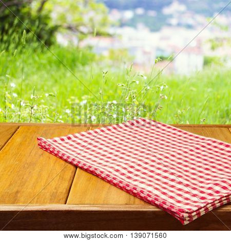 Background for product montage with tablecloth on wooden table