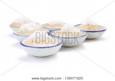 Left front cup steamed banana cake in cup on white floor.