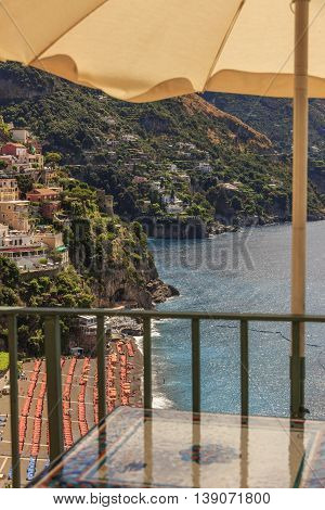 Summertime seascape. Amalfi coast: Positano beach.Italy (Campania).Panoramic view from the tables of a bar.