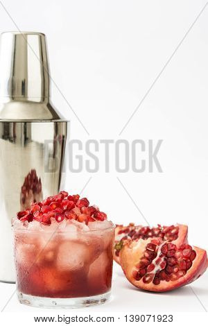 Red cocktail with pomegranate in glass isolated