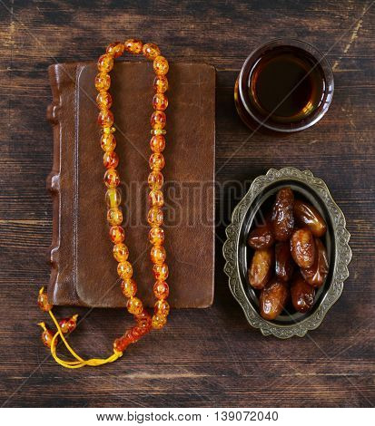 sweet dried dates in vintage silver plate, religious still life