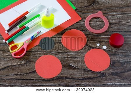 Paper Circles, Sheets Of Paper, Markers, Scissors On A Wooden Table. Paper Ladybug Craft For Childre