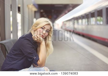 Woman at platform waiting for the train