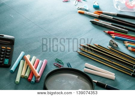 Back to school. School background with supplies. Pencils chalk and school equipment.