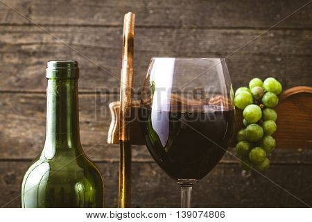 Red wine with grapes. Fresh grapes on wood. Autumn fruit