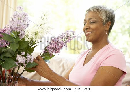 Senior Woman Flower Arranging At Home