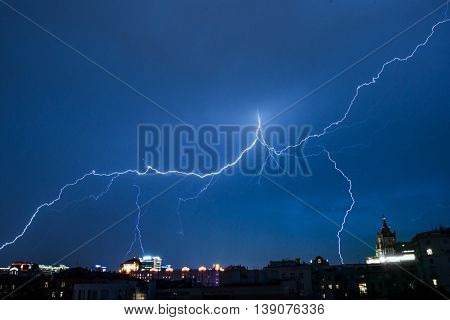 Lightning in Moscow city in blue night