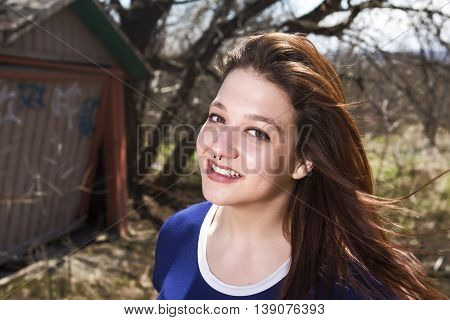 A Girl by Old Barn in forest place